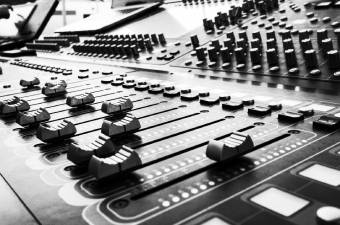 black and white photo of a music studio mixing desk