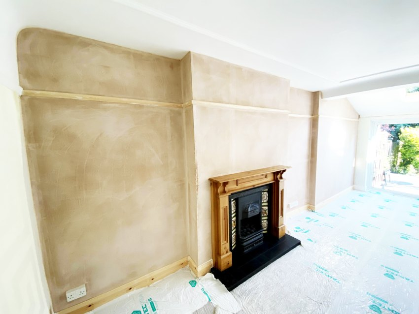 A picture of a plastered lounge party wall including chimney breast after soundproofing has been completed. Soundproof your home